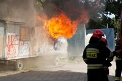 Firefighters fighting a fire of a waste place Royalty Free Stock Photography