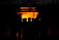 Firefighters in a fire Stock Images