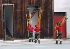 Firefighters during the fire drill mount a ladder Royalty Free Stock Photo