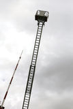 Firefighters in the fire truck basket during the practice of tra Stock Images