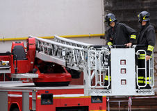 Firefighters in the fire truck basket during the practice of tra Stock Image