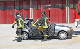 Firefighters freed a wounded trapped in car after an acci Stock Photography