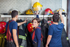 Firefighters Getting Ready In Fire Station Stock Image