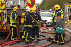 Firefighters at an incident Stock Photo