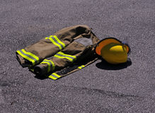 Firefighters jacket and helmet Royalty Free Stock Photo