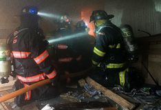 Firefighters at Live Burn Training. Firefighters battle a fire inside a burning farm house during a live burn training in Berlin Vermont. Live Burn trainings Stock Images