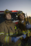 Firefighters Looking Away Stock Images
