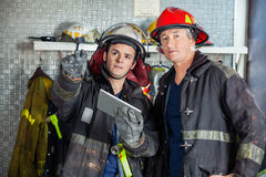 Firefighters Looking Away While Digital Tablet Royalty Free Stock Photography