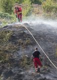 Firefighters tackling summer hill fires in Rhondda. Firefighters near Trebanog, Rhondda pictured after douting another wildfire this time beneath Trebanog Stock Photos