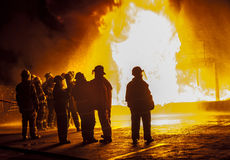 Firefighters observing structural fire Stock Photo