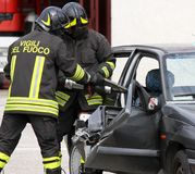 Firefighters open the car with a powerful pneumatic shears Stock Photo
