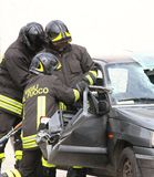 Firefighters open the door of the car with a pneumatic shears Royalty Free Stock Image