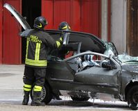 Firefighters open the hood of the car accident Stock Images