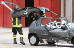 Firefighters open the hood of the car accident Royalty Free Stock Photography