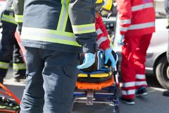 Firefighters and paramedics in a rescue operation after road traffic accident stock photo