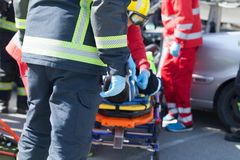 Paramedics and firefighters in a rescue operation after a car crash stock photography