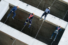 Firefighters practice rappelling on tower. Stock Photography