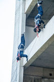 Firefighters practice rappelling on tower. Stock Photos