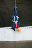 Firefighters practice rappelling on tower. Royalty Free Stock Photo