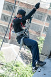 Firefighters practice rappelling on tower. Stock Image