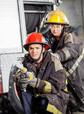 Firefighters Practicing At Fire Station Royalty Free Stock Images