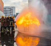 Firefighters prepare to attack a propane fire Stock Photos