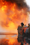 Firefighters prepare to attack a propane fire Royalty Free Stock Images