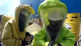 Firefighters prepare to sealing leak of hazardous corrosive toxic materials Royalty Free Stock Image