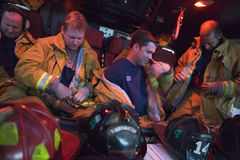 Firefighters preparing for an emergency situation.  Stock Photography