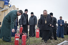 Firefighters and priests Stock Photography