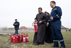 Firefighters and priests Royalty Free Stock Photography