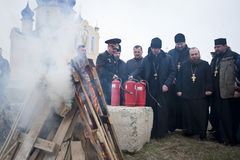 Firefighters and priests Stock Photos