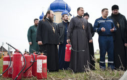Firefighters and priests Stock Photo