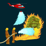 Firefighters in protective clothing and helmet with helicopter extinguish with water from hoses dangerous wildfire.Man Royalty Free Stock Images