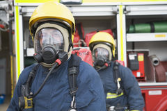Firefighters in protective workwear. Firefighters in protective safety workwear Stock Photo