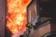 Free Firefighters Put Out Large Massive Fire Blaze, Group Of Fire Men In Uniform During Fire Fighting Operation In The City Streets, Royalty Free Stock Images - 216897039