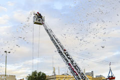 Firefighters on rear platform pumping foam. Firefighters pumping foam into the air from an extended rear mount platform during the celbration of the Virgin Mary Royalty Free Stock Image