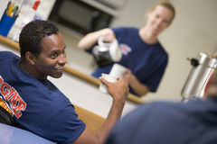 Firefighters relaxing in the staff kitchen Stock Photos