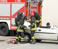 Firefighters relieve an injured after car accident Stock Photography