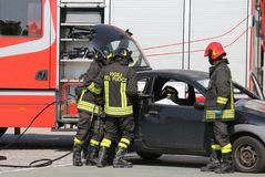Firefighters and relieve the injured in car Stock Photo