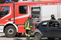 Firefighters and relieve the injured in car Stock Image