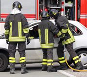 Firefighters relieve an injured after a road accident Stock Image