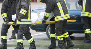 Firefighters rescued the injured after a tragic car accident Stock Images