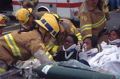 Firefighters and rescuers remove injured stock photos