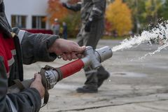 Firefighters spray water during a training exercise royalty free stock image