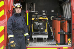 Firefighters standing by the equipment Royalty Free Stock Images