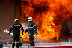 Firefighters struggle to extinguish the fire that broke out at a royalty free stock photo