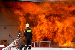 Firefighters struggle to extinguish the fire that broke out at a stock photography