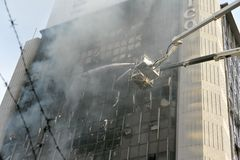Firefighters Tackle a Blaze in an Office Block Stock Images