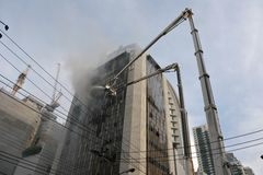 Firefighters Tackle a Blaze in an Office Block Stock Image